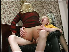 Dressed up in a stripy dress sissy guy acts like a woman jumping on a cock