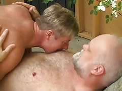 Horny man caresses old bear gay outdoor